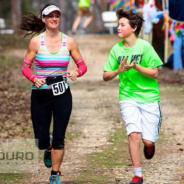 Finishing Rocky 100 miler with my son Cade